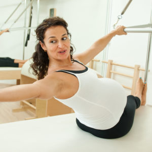 Pregnancy lady pilates reformer