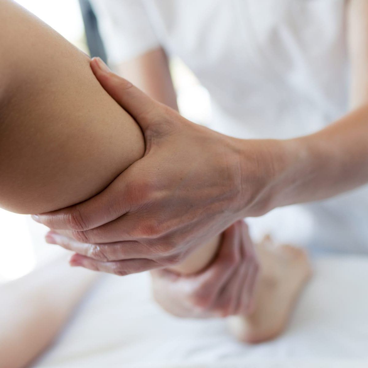 Wellthy Clinic Osteopath treating leg